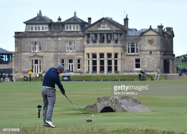 Ireland's amateur golfer Paul Dunne plays towards the clubhouse from the 18th tee during his third round 66 on day four of the 2015 British Open Golf...
