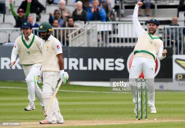 Ireland's Andrew Balbirnie reacts after Pakistan's Asad Shafiq lost his wicket for one run on the final day of Ireland's inaugural test match against...