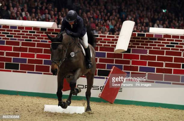 Ireland's Anthony Condon riding Cavalier Rusticana competes in the Cayenne Puissance during day three of the London International Horse Show at...