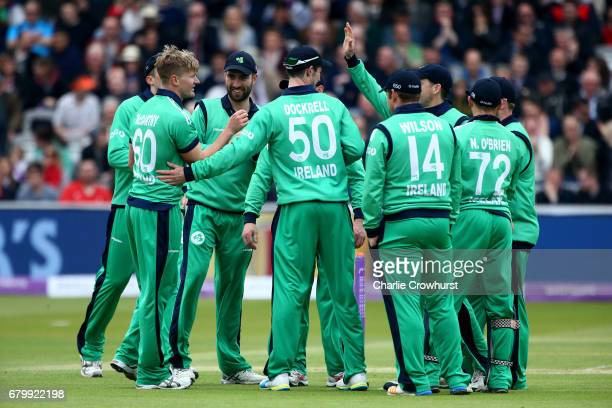 Ireland's Barry McCarthy celebrates with team mates after taking the wicket of Jason Roy during the Royal London ODI between England and Ireland at...