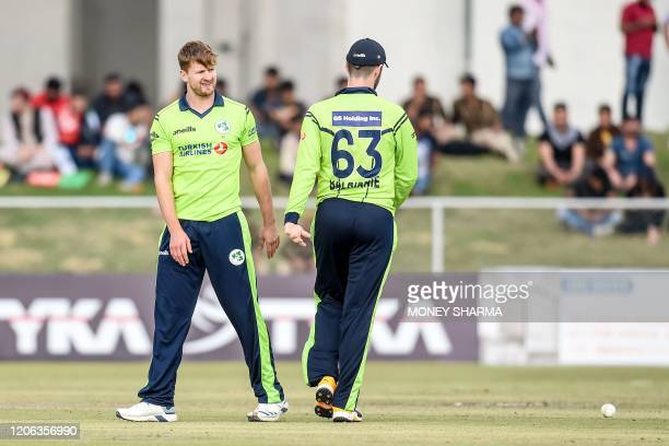 Ireland's Barry McCarthy celebrates with teammate after the dismissal of Afghanistan's Karim Janat during the third T20 between Afghanistan and...