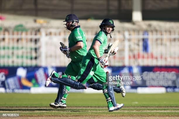 TOPSHOT Ireland's bastmen William Porterfield Paul Stirling run between the wickets during 2nd one day international cricket match between...