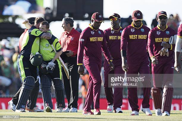 Ireland's batsman John Mooney celebrates with teammate Niall O'Brien as the West Indies team leaves the field after the Pool B 2015 Cricket World Cup...