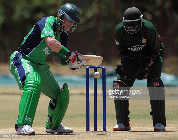 Ireland's batsman John Mooney prepares to hit the ball against Kenya's bowler James Ngoche on February 18 2012 during their twooneday internationals...