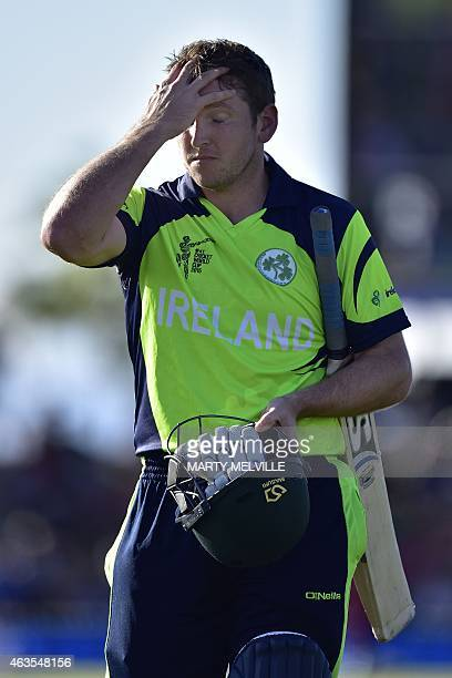 Ireland's batsman Kevin O'Brien walks from the field after being run out during the Pool B 2015 Cricket World Cup match between Ireland and the West...
