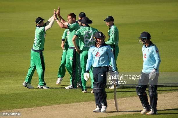 Ireland's bowler Craig Young celebrates taking the wicket of England batsman Jason Roy during the first One Day International cricket match between...