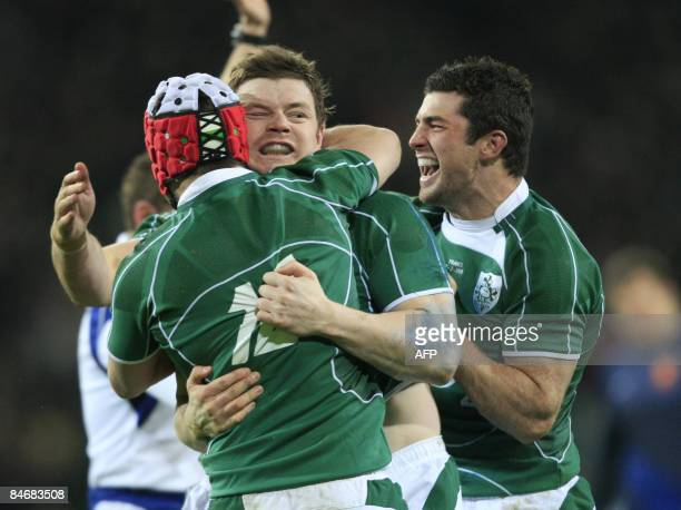 Ireland's Brian O'Driscoll celebrates with teammates Pady Wallace and Robert Kearney after scoring Ireland's first try against France during their...