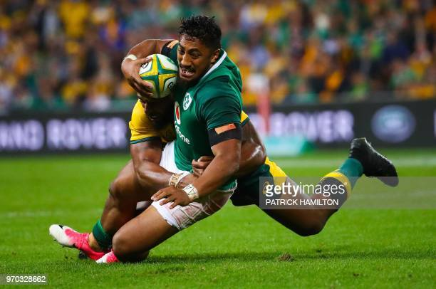 Ireland's Bundee Aki is tackled by Australia's Samu Kerevi during the first rugby Test between Australia and Ireland at Suncorp Stadium in Brisbane...