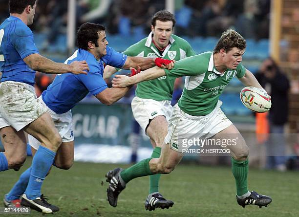 Ireland's center Brian O'Driscoll avoids the tackle of Italy's center Gonzalo Canale, during the VI nations rugby union match between Italy and...