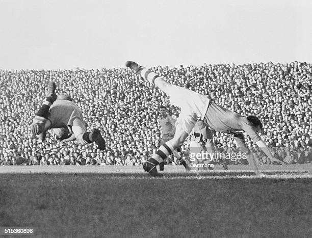 Ireland's center forward, D. Walsh, plunges forward as T. Lindberg, Swedish goalkeeper, saves the ball in the second match between the two teams in...