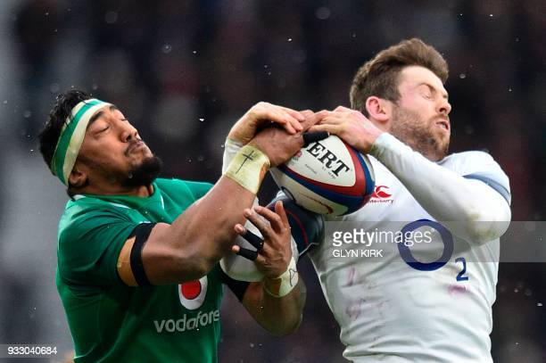 TOPSHOT Ireland's centre Bundee Aki and England's wing Elliot Daly battle over the ball during the Six Nations international rugby union match...