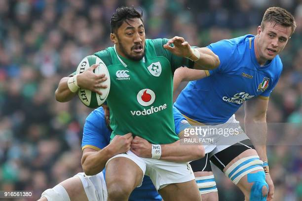 Ireland's centre Bundee Aki is tackled during the Six Nations international rugby union match between Ireland and Italy at the Aviva Stadium in...