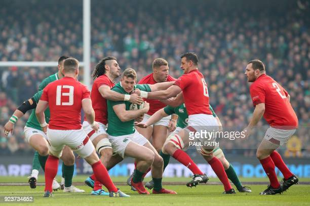 Ireland's centre Chris Farrell is tackled by Wales' flanker Josh Navidi during the Six Nations international rugby union match between Ireland and...