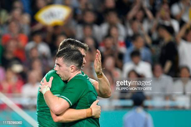 Ireland's centre Garry Ringrose celebrates with Ireland's scrum-half Luke McGrath after scoring a try during the Japan 2019 Rugby World Cup Pool A...