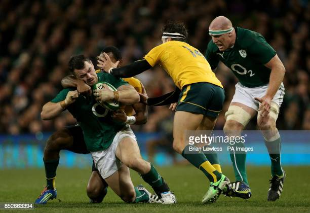 Ireland's Cian Healy and Paul O'Connell tussle with Australia's Tevita Kuridrani and Adam Ashley Cooper during the Guinness Series match at the Aviva...
