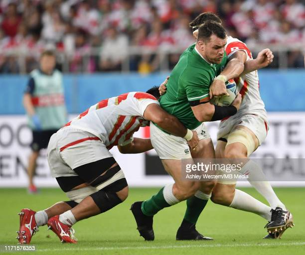 Ireland's Cian Healy is tackled by Japan's Luke Thompson during the Rugby World Cup 2019 Group A game between Japan and Ireland at Shizuoka Stadium...