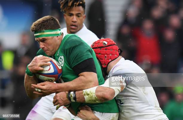 Ireland's CJ Stander evades the tackle of England's James Haskell to score his sides second try during the NatWest Six Nations Championship match...