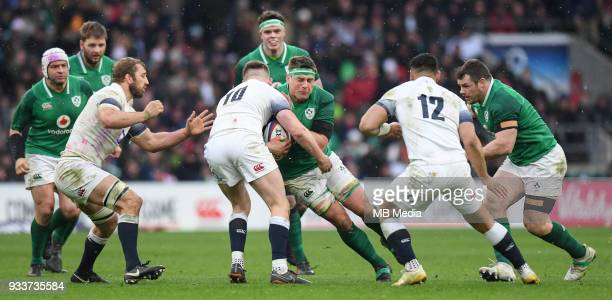 Ireland's CJ Stander is tackled by England's Owen Farrell during the NatWest Six Nations Championship match between England and Ireland at Twickenham...