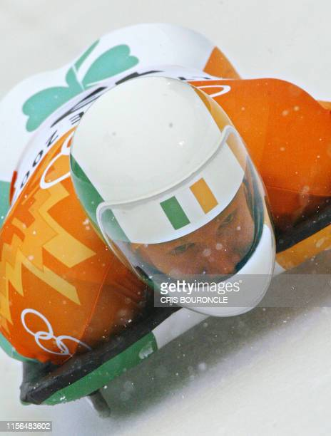 Ireland's Clifton Wrottesley speeds through the ice channel during the first heat for the men's skeleton event during the Salt Lake 2002 Olympic...