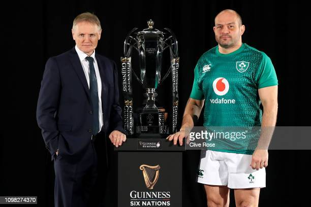 Ireland's Coach Joe Schmidt and Capatain Rory Best pose with the trophy during the 6 Nations Launch event at The Hurlingham Club in west London on...