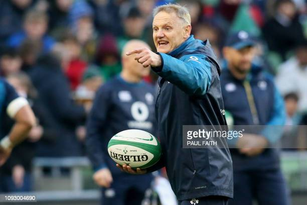 Ireland's coach Joe Schmidt gestures as his players warm up ahead of the Six Nations international rugby union match between Ireland and England at...