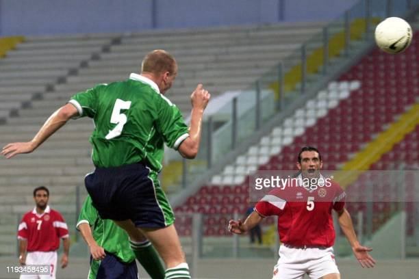 Ireland's Colin Murdock shoots as Malta's Darren Debono looks on in a FIFA World Cup 2001 qualification match 06 October 2001