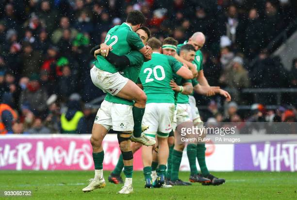 Ireland's Conor Murray and Joey Carbery celebrate winning the grand slam during the NatWest 6 Nations match at Twickenham Stadium London