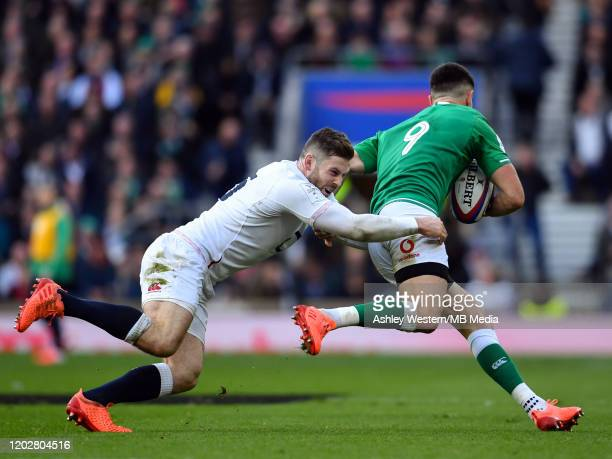 Ireland's Conor Murray is tackled by England's Elliot Daly during the 2020 Guinness Six Nations match between England and Ireland at Twickenham...