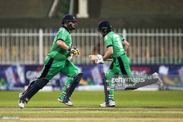 Ireland's cricketer Paul Stirling and William Porterfield run between the wickets during the third one day international cricket match between...