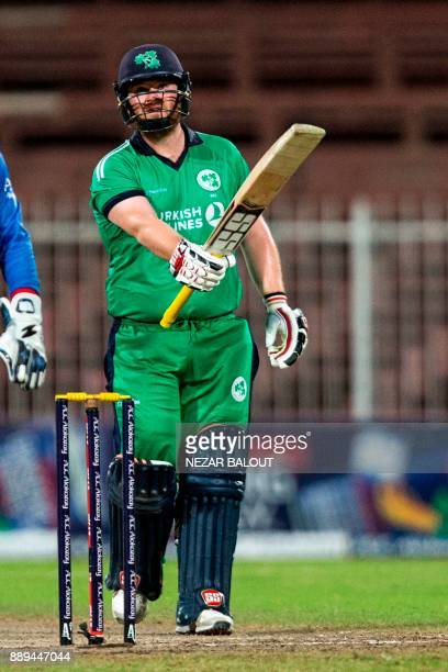 Ireland's cricketer Paul Stirling celebrates after scoring a halfcentury during the third one day international cricket match between Afghanistan and...