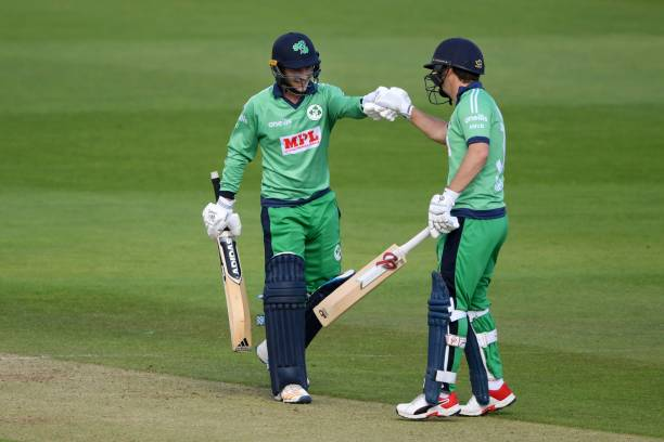 Ireland's Curtis Campher celebrates scoring his halfcentury with Ireland's Andy McBrine during the second One Day International cricket match between...