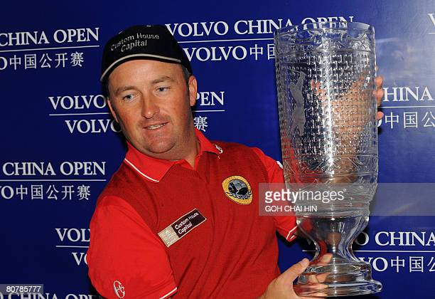 Ireland's Damien McGrane lifts the trophy for the maiden win of his career at the China Open in Beijing on April 20 2008 McGrane scored a 10underpar...