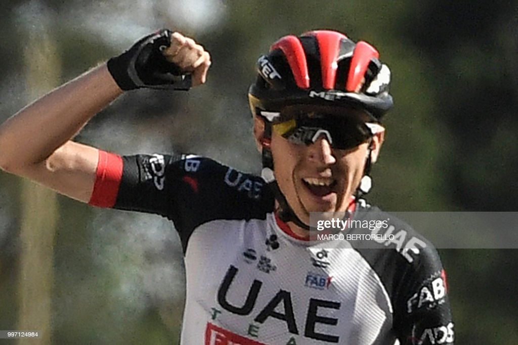 Ireland's Daniel Martin celebrates as he crosses the finish line to win the sixth stage of the 105th edition of the Tour de France cycling race between Brest and Mur-de-Bretagne Guerledan, western France, on July 12, 2018. (Photo by Marco BERTORELLO / AFP) / ALTERNATIVE