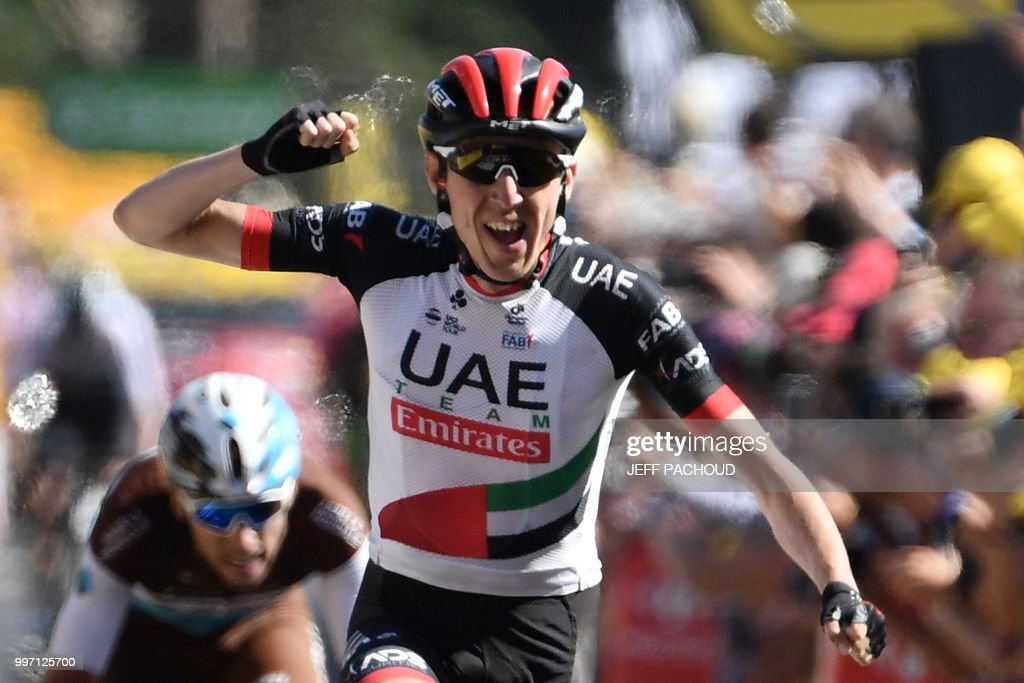 Ireland's Daniel Martin celebrates as he crosses the finish line to win the sixth stage of the 105th edition of the Tour de France cycling race between Brest and Mur-de-Bretagne Guerledan, western France, on July 12, 2018. (Photo by Jeff PACHOUD / AFP) / ALTERNATIVE