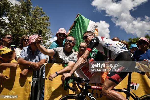 Ireland's Daniel Martin poses for selfie photos with spectators within the signing in ceremony prior to the 15th stage of the 105th edition of the...