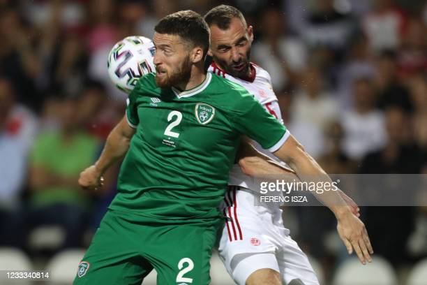 Ireland's defender Matt Doherty and Hungary's midfielder Attila Fiola vie for a header during the friendly football match between Hungary and the...