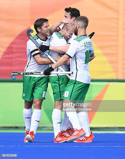 Ireland's Eugene Magee celebrates scoring a goal during the men's field hockey Germany vs Ireland match of the Rio 2016 Olympics Games at the Olympic...