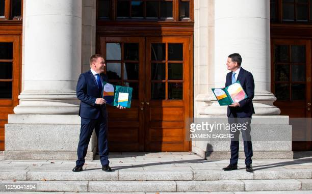 Ireland's Finance Minister, Paschal Donohoe and Ireland's Minister for Public Expenditure and Reform, Michael McGrath, social distance as they pose...