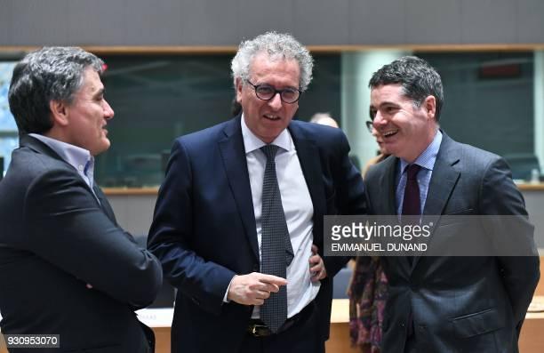 Ireland's Finance Minister Paschal Donohoe Luxembourg's Finance Minister Pierre Gramegna and Greece's Finance Minister Euclid Tsakalotos attend a...