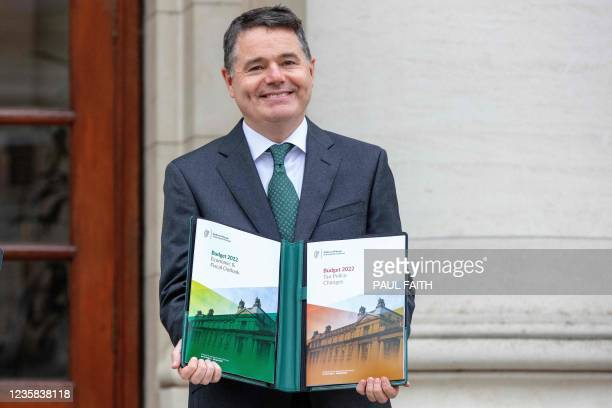 Ireland's Finance Minister Paschal Donohoe poses at a photocall prior to presenting the 2022 Irish Budget to Parliament at Government Buildings in...