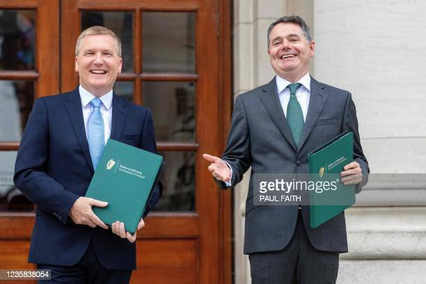 Ireland's Finance Minister Paschal Donohoe poses with Ireland's Minister for Public Expenditure and Reform Michael McGrath at a photocall prior to...