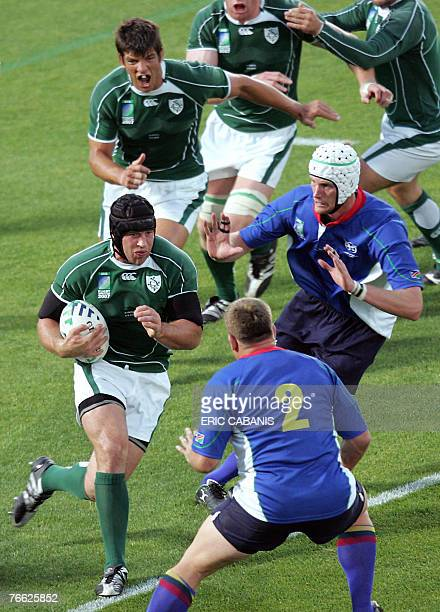 Ireland's flanker Denis Leamy vies with Namibia's lock Nico Esterhuizen and Namibia's hooker Hugo Horn during the rugby union World Cup match Ireland...