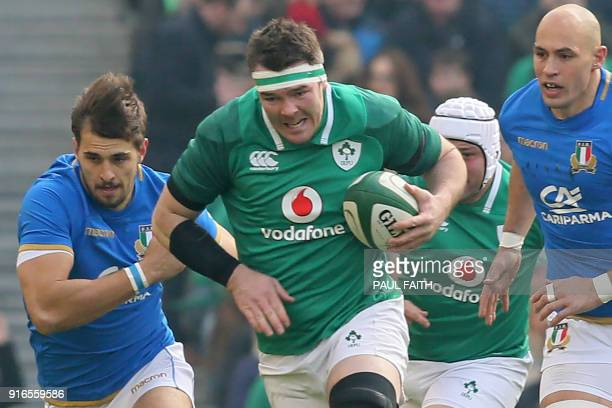 Ireland's flanker Peter O'Mahony makes a break during the Six Nations international rugby union match between Ireland and Italy at the Aviva Stadium...