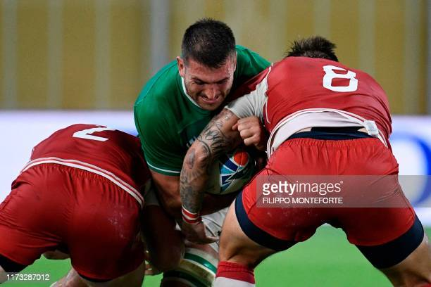 Ireland's flanker Rhys Ruddock is tackled during the Japan 2019 Rugby World Cup Pool A match between Ireland and Russia at the Kobe Misaki Stadium in...
