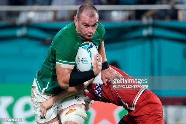 Ireland's flanker Rhys Ruddock runs to score a try during the Japan 2019 Rugby World Cup Pool A match between Ireland and Russia at the Kobe Misaki...