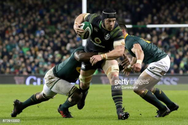 Ireland's flanker Sean O'Brien is tackled during the autumn international rugby union test match between Ireland and South Africa at the Aviva...