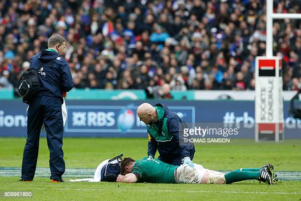 Ireland's flanker Sean O'Brien lies on the pitch during the Six Nations international rugby union match between France and Ireland at the Stade de...