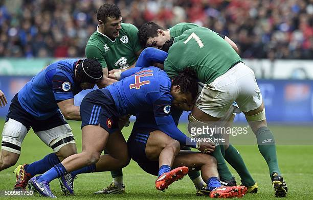 Ireland's flanker Sean O'Brien vies with France's Teddy Thomas during the Six Nations international rugby union match between France and Ireland on...