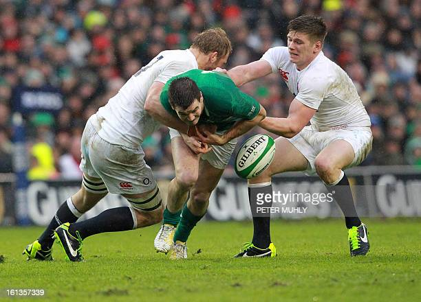 Ireland's fly half Jonathan Sexton is tackled by England's flanker Chris Robshaw and England's fly half Owen Farrell during the Six Nations...