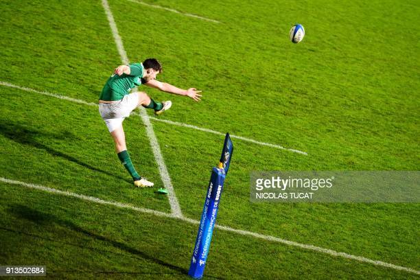 TOPSHOT Ireland's flyhalf Harry Byrne kicks the ball during the Six Nations U20 rugby match France versus Ireland on February 2 2018 at the...